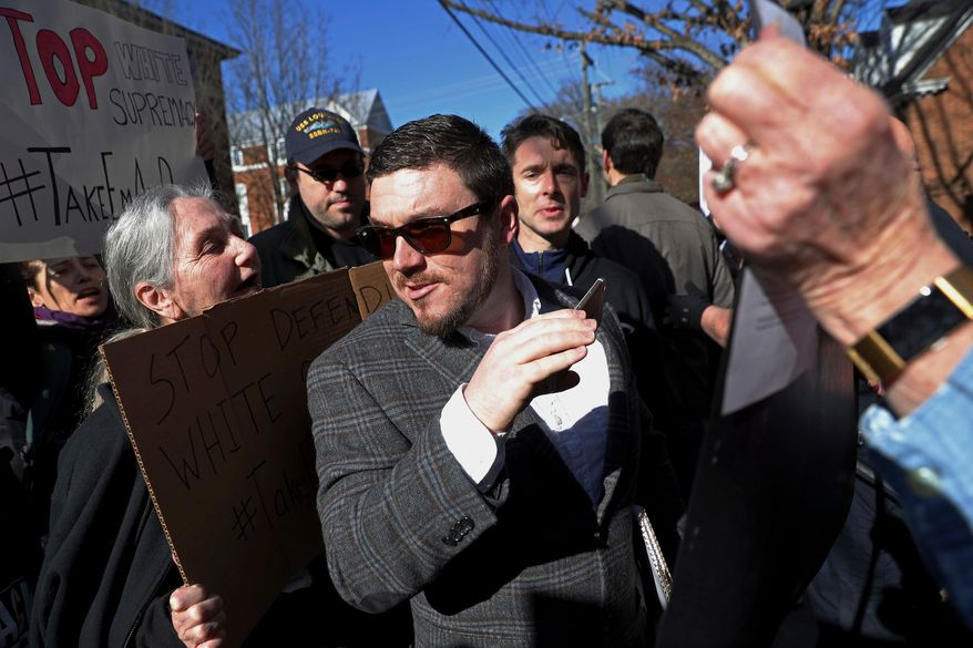 In this Feb. 27, 2018, file photo, Jason Kessler walks through a crowd of protesters in front of the Charlottesville Circuit Courthouse ahead of a decision regarding the covered Confederate statues, during a rally in Charlottesville, Va. (Zack Wajsgras/The Daily Progress via AP)