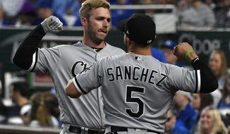 Chicago White Sox Matt Davidson, back, celebrates his home run with Yolmer Sanchez (5) during the fourth inning of the team's baseball game against the Kansas City Royals on Thursday, April 26, 2018, in Kansas City, Mo. (AP Photo/Ed Zurga)