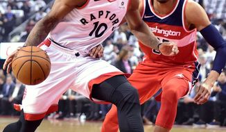 Toronto Raptors' DeMar DeRozan drives against Washington Wizards Otto Porter Jr. during the first half of Game 5 of an NBA basketball first-round playoff series Wednesday, April 25, 2018, in Toronto. (Frank Gunn/The Canadian Press via AP)