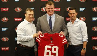 49ers general manager John Lynch, left, introduces first-round pick Mike McGlinchey, center, with coach Kyle Shanahan, right, during an NFL football news conference, Friday, April 27, 2018, in Santa Clara, Calif. (AP Photo/Josie Lepe )