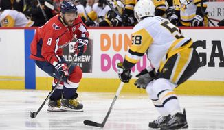 Washington Capitals left wing Alex Ovechkin (8), of Russia, skates with the puck against Pittsburgh Penguins defenseman Kris Letang (58) during the second period in Game 1 of an NHL second-round hockey playoff series, Thursday, April 26, 2018, in Washington. (AP Photo/Nick Wass) ** FILE **