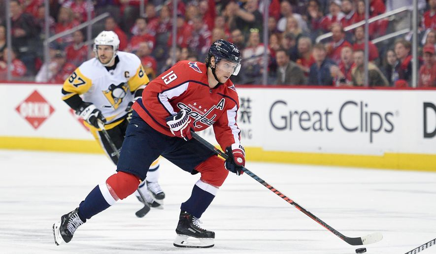 Washington Capitals center Nicklas Backstrom (19), of Sweden,skates with the puck past Pittsburgh Penguins center Sidney Crosby (87) during the second period in Game 1 of an NHL second-round hockey playoff series, Thursday, April 26, 2018, in Washington. (AP Photo/Nick Wass) **FILE**