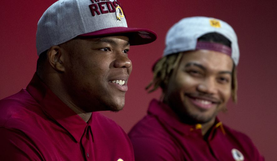 Redskins players Da'Ron Payne, left, and Derrius Guice, first and second round selections of the 2018 NFL Draft, attend a news conference, during Redskins 2018 Draft Fest, in Landover, Md., Saturday, April 28, 2018. ( AP Photo/Jose Luis Magana)