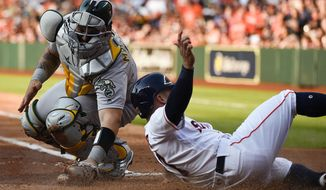 Houston Astros' Jose Altuve, right, slides safely past Oakland Athletics catcher Bruce Maxwell to score on Josh Reddick's sacrifice fly during the first inning of a baseball game, Saturday, April 28, 2018, in Houston. (AP Photo/Eric Christian Smith)