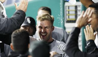 Chicago White Sox designated hitter Matt Davidson is congratulated in the dugout after hitting a two-run home run in the 11th inning of a baseball game against the Kansas City Royals at Kauffman Stadium in Kansas City, Mo., Friday April. 27, 2018. (AP Photo/Colin E. Braley)