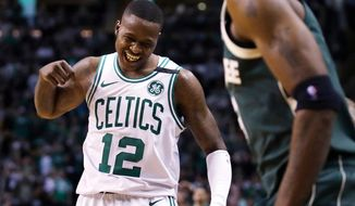 Boston Celtics guard Terry Rozier (12) celebrates after a basket against the Milwaukee Bucks during the fourth quarter of Game 7 of an NBA basketball first-round playoff series in Boston, Saturday, April 28, 2018. At right is Bucks guard Jason Terry. The Celtics won 112-96, eliminating the Bucks from the playoffs. (AP Photo/Charles Krupa)