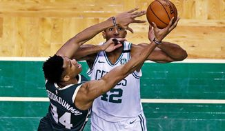 Milwaukee Bucks forward Giannis Antetokounmpo (34) drives to the basket against Boston Celtics forward Al Horford (42) during the first quarter of Game 7 of an NBA basketball first-round playoff series in Boston, Saturday, April 28, 2018. (AP Photo/Charles Krupa)