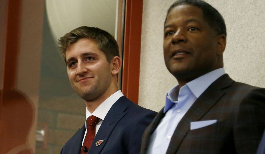 The Arizona Cardinals introduce their first-round NFL football draft pick Josh Rosen, left, as he stands next to head coach Steve Wilks, right, Friday, April 27, 2018, in Tempe, Ariz. (AP Photo/Ross D. Franklin)