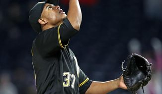 Pittsburgh Pirates relief pitcher Edgar Santana celebrates getting the final out of a 6-2 Pirates win over the St. Louis Cardinals in a baseball game in Pittsburgh, Saturday, April 28, 2018. (AP Photo/Gene J. Puskar)