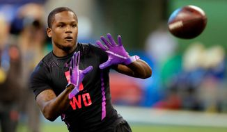FILE - In this March 3, 2018, file photo, Florida wide receiver Antonio Callaway runs a drill at the NFL football scouting combine in Indianapolis. The Cleveland  Browns are counting on Callaway to outrun his troubled past. Callaway, who has had numerous legal issues, was drafted by Cleveland in the fourth round of the NFL draft on Saturday, April 28, 2018. (AP Photo/Michael Conroy, File)