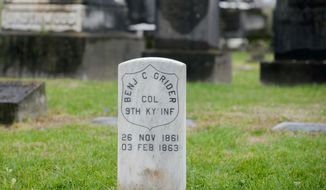 In a Saturday, April 14, 2018 photo, a military headstone for Col. Benjamin C. Grider stands at Fairview Cemetery in Bowling Green, Ky. The 9th Kentucky Volunteer Infantry Regiment, a re-enactment group that portrays the Civil War soldiers who fought for the Union in the regiment of the same name, raised funds from within their membership to buy a marble grave marker commemorating Grider's military service and place it at his gravesite. (Bac Totrong/Daily News via AP)
