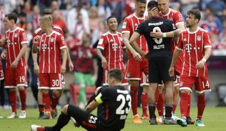 Bayern's Niklas Suele hugs Frankfurt's Simon Falette after the German Bundesliga soccer match between FC Bayern Munich and Eintracht Frankfurt at the Allianz Arena stadium in Munich, Germany, Saturday, April 28, 2018. (AP Photo/Matthias Schrader)