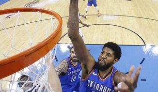 Oklahoma City Thunder forward Paul George (13) shoots during the second half of Game 5 of the team's NBA basketball first-round playoff series against the Utah Jazz in Oklahoma City, Wednesday, April 25, 2018. (AP Photo/Sue Ogrocki)