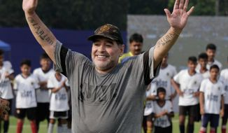 FILE - In this Dec. 12, 2017, file photo, Diego Maradona gestures as he attends a football clinic and workshop for young aspiring soccer players in Kadambagachhi, north of Kolkata, India.  Diego Maradona has left his coaching job in the United Arab Emirates after the team he was in charge of failed to win automatic promotion to the premier division. (AP Photo/Bikas Das, File)