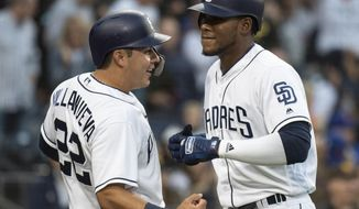 San Diego Padres' Franchy Cordero, right, and Christian Villanueva celebrate Cordero's three-run home run during the fourth inning of a baseball game against the New York Mets in San Diego, Saturday, April 28, 2018. (AP Photo/Kyusung Gong)