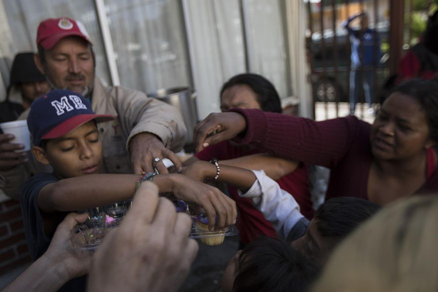 """Migrants have their breakfast at the """"Vina de Tijuana AC"""" migrant shelter in Tijuana, Mexico, Saturday, April 28, 2018. As the migrants prepare to walk to the """"Casa del Tunel"""" to get legal advice from U.S. immigration lawyers, they are telling Central Americans in a caravan of asylum-seekers they may be separated from their children and detained for many months. (AP Photo/Hans-Maximo Musielik)"""