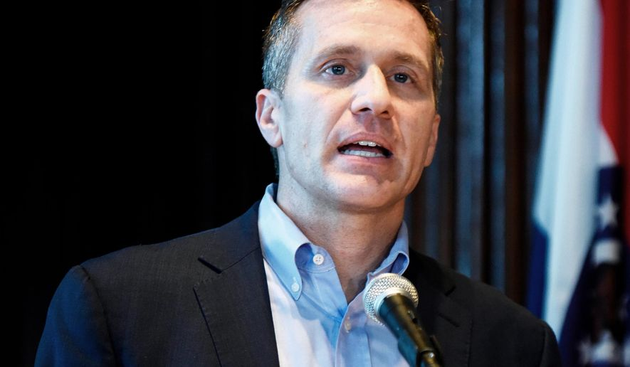 FILE - In this April 11, 2018, file photo, Missouri Gov. Eric Greitens speaks at a news conference in Jefferson City, Mo., about allegations related to his extramarital affair with his hairdresser. The Missouri Supreme Court says a woman who had an extramarital affair with Greitens must turn over her cellphone for a forensic investigation. The Kansas City Star reported Saturday, April 28 that the high court's decision follows the woman's request Friday to block an order requiring her phone to be examined by a court-appointed expert.   (Julie Smith /The Jefferson City News-Tribune via AP, File)