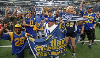 Los Angels Rams fans cheer during the NFL football draft in Arlington, Texas, Saturday, April 28, 2018. (Jae S. Lee/The Dallas Morning News via AP)