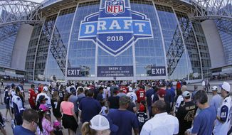 People wait to get into the stadium for the second round of the NFL football draft in Arlington, Texas, Friday, April 27, 2018. (Paul Moseley/Star-Telegram via AP)