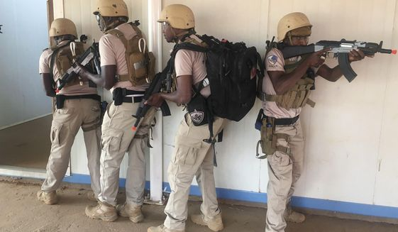 In this photo taken Friday, April 13, 2018. Nigerien police who are part of the U.S. Special Program for Embassy Augmentation and Response, known as SPEAR take part in the annual U.S.-led Flintlock exercise in Niamey, Niger. Amid questions over the role of the U.S. military in West Africa's vast Sahel region, the State Department is pouring millions of dollars into training local law enforcement officers in the hopes that extremism can be better countered at the community level. (AP Photo/Carley Petesch)