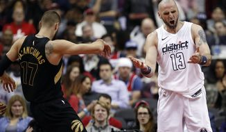Washington Wizards center Marcin Gortat, right, reacts after being called for a foul on Toronto Raptors center Jonas Valanciunas during the second half of Game 6 of an NBA basketball first-round playoff series Friday, April 27, 2018, in Washington. The Raptors won 102-92. (AP Photo/Alex Brandon)