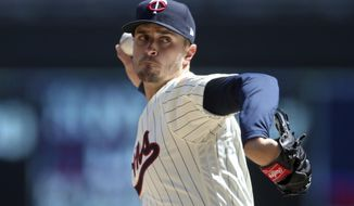 Minnesota Twins pitcher Jake Odorizzi throws against the Cincinnati Reds in the first inning of a baseball game Saturday, April 28, 2018, in Minneapolis. (AP Photo/Jim Mone)