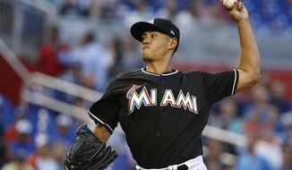 Miami Marlins' Wei-Yin Chen, of Taiwan, delivers a pitch during the first inning of the team's baseball game against the Colorado Rockies, Saturday, April 28, 2018, in Miami. (AP Photo/Wilfredo Lee)