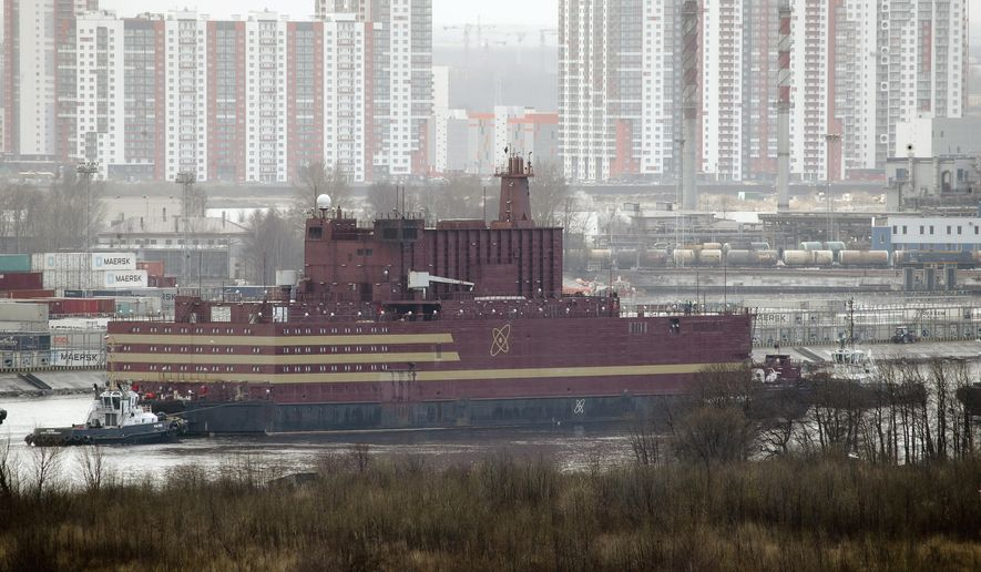 The floating nuclear power plant, the 'Akademik Lomonosov', is towed out of the St. Petersburg shipyard where it was constructed in St.Petersburg, Russia, Saturday, April 28, 2018. The Akademik Lomonosov is to be loaded with nuclear fuel in Murmansk, then towed to position in the Far East in 2019. (AP Photo/Dmitri Lovetsky)