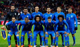 In this photo taken on Friday, March 23, 2018, the Brazilian players pose before an international friendly soccer match between Russia and Brazil at the Luzhniki stadium in Moscow. (AP Photo/Alexander Zemlianichenko)