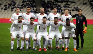 In this photo taken on Friday, March 23, 2018, Switzerland team poses for the photographers before an international friendly soccer match against Greece at the Olympic stadium in Athens. (AP Photo/Thanassis Stavrakis)