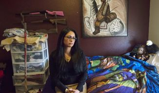 In this Tuesday, April 10, 2018, photograph, Lydia Lerma, the mother of the first victim who came forward in a child sexual assault case against Andrew Vanderwal, poses for a portrait in her child's bedroom in her home in Fort Collins, Colo. (Timothy Hurst/The Coloradoan via AP)