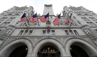FILE - This Dec. 21, 2016, file photo shows the The Trump International Hotel on Pennsylvania Avenue in Washington. The Philippines is the latest foreign government to plan an event at Donald Trump's Washington hotel, even as the president faces lawsuits alleging he is violating the Constitution by accepting such business. The Philippines says the hotel is a fitting venue for its June 12 Independence Day party because other embassies have held national celebrations there, but ethics experts question the motive for the choice, especially since the Philippines is currently negotiating a trade deal with the U.S. (AP Photo/Alex Brandon, File)