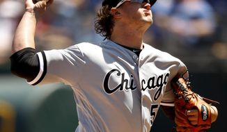 Chicago White Sox starting pitcher Carson Fulmer throws during the first inning of the first baseball game in a doubleheader against the Kansas City Royals Saturday, April 28, 2018, in Kansas City, Mo. (AP Photo/Charlie Riedel)