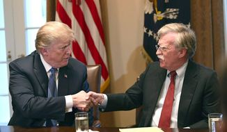 "National security adviser John Bolton (right) told CBS that President Trump seeks commitment rather than ""words"" from North Korea. (Associated Press)"
