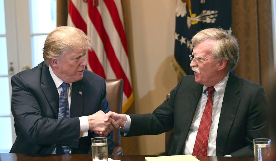 """National security adviser John Bolton (right) told CBS that President Trump seeks commitment rather than """"words"""" from North Korea. (Associated Press)"""