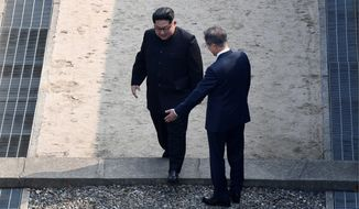 North Korean leader Kim Jong-un (left) and South Korean President Moon Jae-in reportedly agreed to gradual arms reduction and to replace their military tension with trust. (Associated Press)
