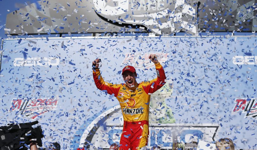 NASCAR driver Joey Logano celebrates in Victory Lane after winning the NASCAR Talladega auto race at Talladega Superspeedway, Sunday, April 29, 2018, in Talladega, Ala. (AP Photo/Brynn Anderson)