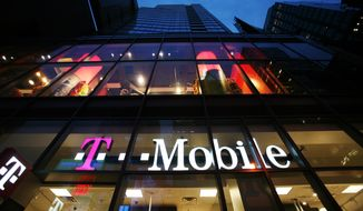 A T-Mobile retail store is shown in Times Square on Tuesday, March 18, 2008 in New York. T-Mobile is Deutsche Telekom's wireless unit. (AP Photo/Mark Lennihan)