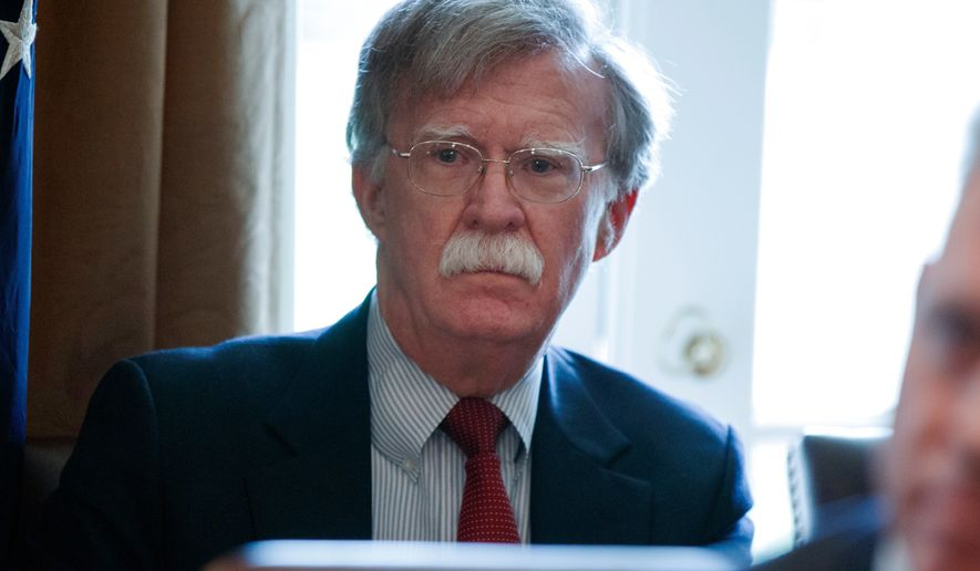 FILE - In this April 9, 2018 file photo, National security adviser John Bolton listens as President Donald Trump speaks during a cabinet meeting at the White House in Washington. Shortly before he became Trumps national security adviser, John Bolton told Radio Free Asia that nuclear negotiations with North Korea should be similar to past discussions with Libya, which dismantled its rudimentary nuclear program in the 2000s. (AP Photo/Evan Vucci, File)