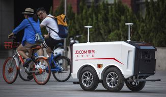 "An autonomous delivery vehicle targeted toward the ""spoiled Chinese"" consumer is an example of artificial intelligence coming out of Silicon Valley, which has an uncomfortable relationship with the Pentagon and the CIA. (Associated Press/File)"