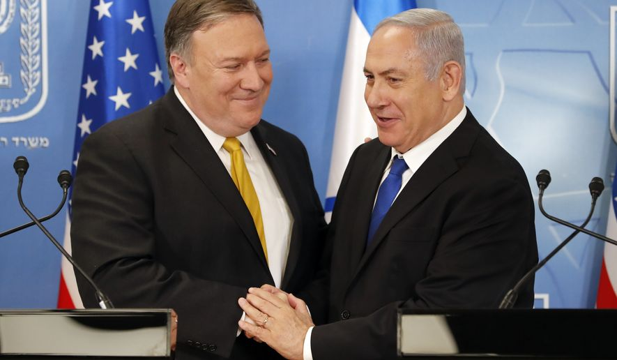 U.S. Secretary of State Mike Pompeo. left. is greeted by Israeli Prime Minister Benjamin Netanyahu ahead of a press conference at the Ministry of Defense in Tel Aviv, Sunday, April 29, 2018. (Thomas Coex, AFP via AP)