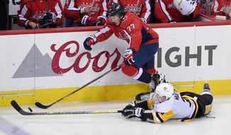 Washington Capitals right wing T.J. Oshie (77) chases the puck against Pittsburgh Penguins defenseman Olli Maatta (3), of Finland, during the third period in Game 2 of an NHL second-round hockey playoff series, Sunday, April 29, 2018, in Washington. The Capitals won 4-1. (AP Photo/Nick Wass) ** FILE **