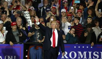 U.S. President Donald Trump waves after a campaign rally in Washington Township, Mich., Saturday, April 28, 2018. (AP Photo/Paul Sancya)