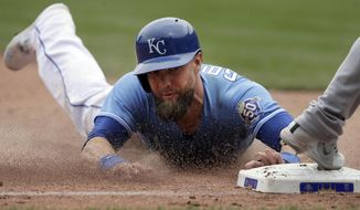 Kansas City Royals' Alex Gordon slides into third base during the sixth inning of a baseball game against the Chicago White Sox at Kauffman Stadium in Kansas City, Mo., Sunday, April 29, 2018. Gordon advanced on a wild pitch. (AP Photo/Orlin Wagner)