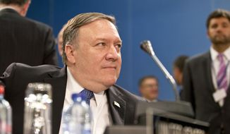 U.S. Secretary of State Mike Pompeo waits for the start of a meeting of NATO foreign ministers at NATO headquarters in Brussels on Friday, April 27, 2018. NATO is set on Friday to hold its last major meeting in its old headquarters, with talks focused on strained ties with Russia, a fresh peace effort in Afghanistan and a new training mission for Iraq. (AP Photo/Virginia Mayo)