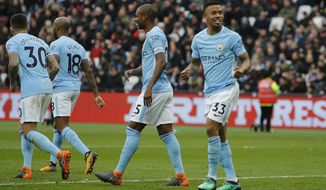 Manchester City's Gabriel Jesus, right, celebrates after scoring his side's third goal during the English Premier League soccer match between West Ham United and Manchester City at the London stadium in London, Sunday, April, 29, 2018. (AP Photo/Alastair Grant)