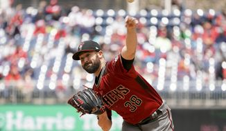 Arizona Diamondbacks starting pitcher Robbie Ray (38) pitches during the first inning of a baseball game against the Washington Nationals at Nationals Park Sunday, April 29, 2018, in Washington. (AP Photo/Andrew Harnik)