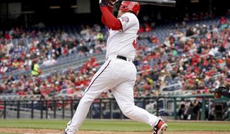 Washington Nationals' Matt Wieters (32) hits a home run during the second inning of a baseball game against the Arizona Diamondbacks at Nationals Park, Sunday, April 29, 2018, in Washington. (AP Photo/Andrew Harnik)