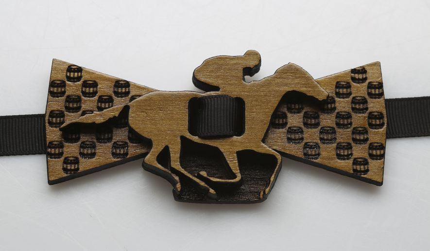 In this Jan. 18, 2017 photo, a wooden bowtie from StoryWood Bowties is displayed in Louisville, Ky. The bowties are made from reclaimed wood that has been repurposed and sold with a story.   (Sam Upshaw Jr./Courier Journal via AP)