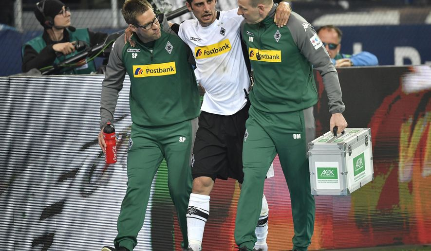 Moenchengladbach's Lars Stindl leaves the pitch injured during the German Bundesliga soccer match between FC Schalke 04 and Borussia Moenchengladbach in Gelsenkirchen, Germany, Saturday, April 28, 2018. (AP Photo/Martin Meissner)